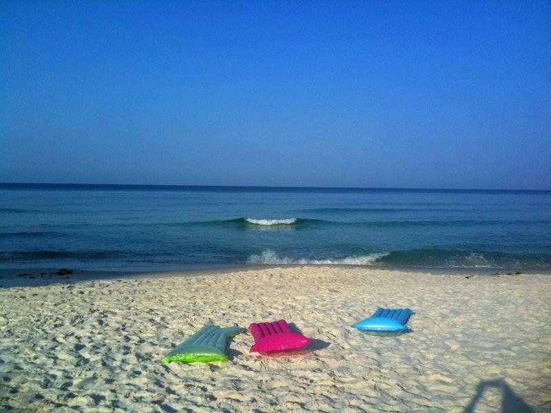3 floats on the beach